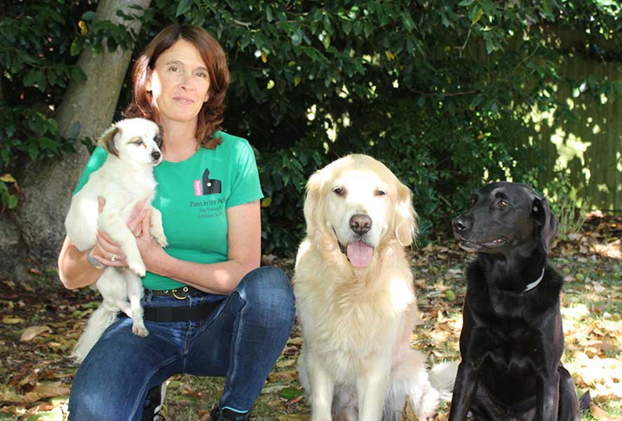 an image of Kiri Downes with her dogs